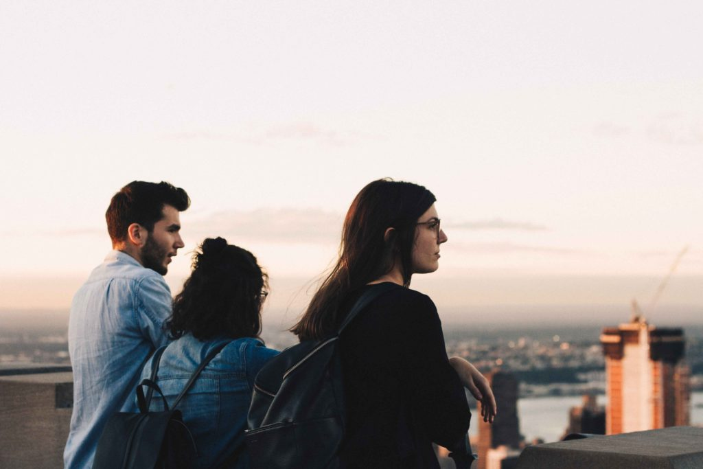 my friends admiring the view from the top of the rock in New York city at golden hour