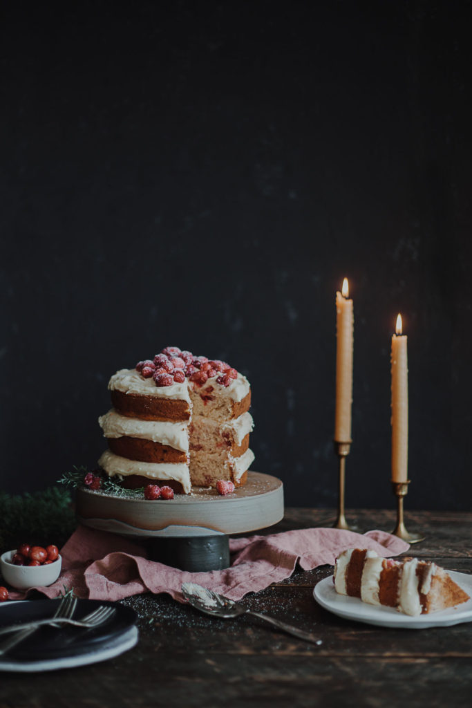 Christmas cake perfect for the holiday season full of cranberries and orange table setting