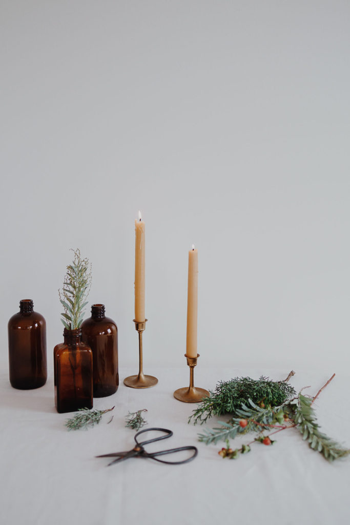christmas setting with burning candles and greenery holidays decoration